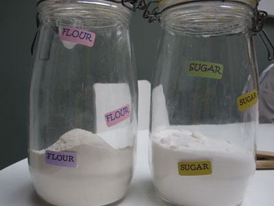 Jars of flour and sugar, with name tags